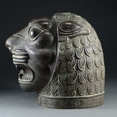 Historic Selection of the Week: Lion Head Isfahan, Persia Lion Head c. 1870 Repoussé silver with patina x x 9 inches This extraordinary and Celtic Dragon, Celtic Art, Ancient Mesopotamia, Ancient Civilizations, Islamic Art Calligraphy, Calligraphy Alphabet, Stone Lion, Achaemenid, Fu Dog