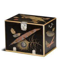 japaneseaesthetics:  A fine togidashi lacquer box (kobako) By Izuka Toyo II (1766-1844), Edo period (19th century) The rectangular box with a drop front opening to reveal two drawers, all decorated with a variety of feathers finely worked in gold, silver, red, brown and black togidashi on a glossy roironuri ground, several of the feathers embellished with inlaid aogai, the edges of the box fundame decorated with scrolling vines in gold hiramakie, interior of drawers roironuri, silver…