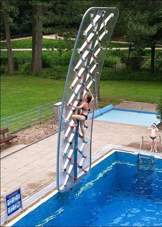 this poolside rock climbing wall will take your backyard to new heights