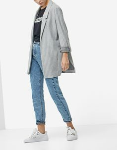 white sneakers, high waisted jeans, black top, grey striped blazer