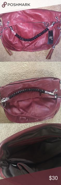 Red DS bag Red leather bag One pocket On the outside tassels  hanging from the side  two ways to hold one over the shoulder one carrying in hand big inside pocket with smaller pockets inside beads for the handles Bags Hobos