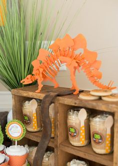 """dinosaur party decorations and """"Dig in"""" puddings with chocolate bones!"""