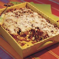 This lasagna-like ground beef casserole has wide egg noodles instead of lasagna noodles, so there's no layering required. You simply add a jar of spaghetti sauce to the cooked ground beef, stir in the noodles and a creamy, cheesy spinach mixture, and bake.