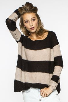 Super soft lightweight sweater, great with a cute skirt, tights, and boots.