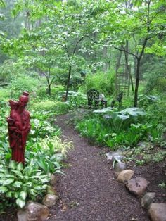 Red Chinese Statue in Naturalized Garden