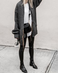 I am obsessed with this outfit. I love her boots and her leggings. I need leggings like these in my closet! I also adore her long cardigan and her bag! The outfit is perfect for fall or even winter depending on where you live.