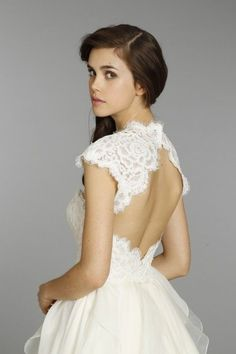 wedding dress with sleeves, lace wedding dress, keyhole back wedding dress, bolero wedding dress, Hayley Paige Kira gown and bolero available at Wildflower Bridal
