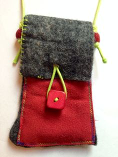 Hand made industrial felt with a variety of pockets for Vape accessories. Bright cord, beads and buttons.  https://m.facebook.com/redebris