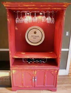 Old entertainment center upcycled to a wine bar or cabinet