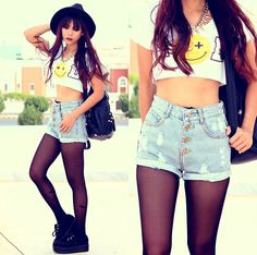 Hat, Gun Belt Necklace, Smiley Face Midriff Top, High Rise Denim Shorts, Tights, Creepers