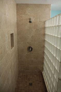 Walk in showers are all the rage - get rid of nasty framed doors forever! This custom tile shower project in Cleveland Ohio with a curved glass block wall is easy to clean and stylish..  More examples in the gallery: http://innovatebuildingsolutions.com/products/glass-block/glass-block-shower