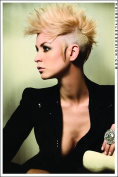 Edgy punk short haircut. Shaved sides with a bleached blonde super sexy mohawk.  Mandy MacFadden Winner: Best Ontario Hairstylist/Texture Hairstylist