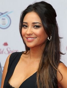 Shay Mitchell. She is so cute & I am jealous of her hair!!