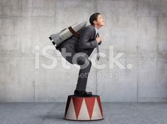 Businessman Preparing For Takeoff On Circus Pedestal royalty-free stock photo