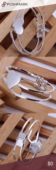 """🎄 SWEETHEART BANGLE 🎄 This is a platinum plated over Sterling silver (925) Sweetheart Bangle. This will fit a 8"""" wrist. The bangle measurements are: 2 3/8""""W is the bangle interior diameter. 1 3/4""""H is the interior height of the bangle. 7/16""""W is the width of the bangle band. The heart is 15/16""""W X 7/8""""H. Jewelry Bracelets"""