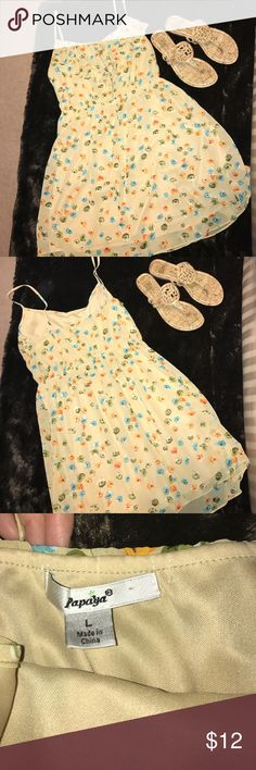 Papaya Flower Printed Short Dress. Short tan dress with printed flowers throughout. Spaghetti strap with ruffled top on front. Flowers are orange, green, blue, and slight purple. Great for spring! Good used condition. Papaya Dresses