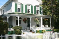 Mackinac Island Cottage - white picket fence. I know Mackinac Island is no where near the south, but this looks very southern to me.