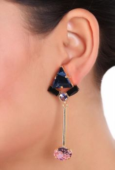 Sparkling earrings crafted in gold plated brass studded with denim blue, tanzanite and rose swarovski crystals with black enamel. The beautiful design renders it versatility to be worn for all occasions. Dimension: L: 3.5 inch Weight: 14 gm Color: Blue, pink & black Material: Brass and Swarovski crystals Closure: Post Finish: Hand-crafted Inspiration: Colours of Life