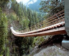 Bridge-stair at the Traversinertobel (Switzerland) odesigned by engineer Jürg Conzett and his associate Rolf Bachofner . They solved the problem of connecting two different elevations over the gorge by creating a staircase. The staircase replaces a rope bridge for hikers that was wiped out by a rock slide.