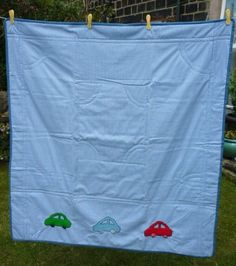 Blue gingham children's quilt with cars £35.00