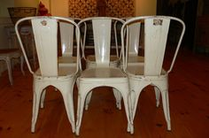 Vintage French Industrial chairs...Tolix chairs.  6,600.00  No wonder I love them so.