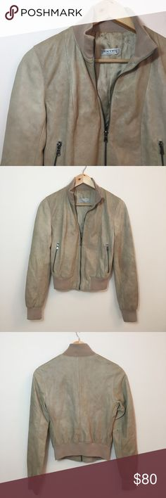 """Vintage Italian Leather Bomber Jacket Preloved vintage bomber jacket made with 100% Italian leather. The front is longer than the back.   No size tag so please reference measurements. These measurements are with the jacket zipped up.   Chest: 33"""" Length (back): 21"""" Vintage Jackets & Coats"""