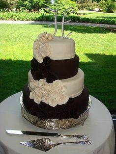 Brown and Ivory Wedding Cake...could do eggplant and ivory