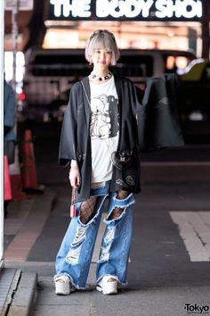 20-year-old Rikarin on the street in Harajuku wearing a kimono jacket from Funky Fruit with a Monomania tee, ripped Fig&Viper jeans over fishnets, platform sandals, and accessories from 6%DOKIDOKI.
