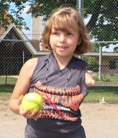 9-year-old softball player overcomes leg, arm disabilities with 'CAN DO' spirit !