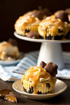 You don't need a reason (other than you're hungry) to enjoy these Mini Caramel Cheesecakes with a chocolate cookie crust, caramel cheesecake filling, caramel whipped cream, and caramel nut clusters.