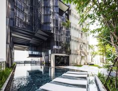 Completed in 2014 in Bangkok, Thailand. Images by Spaceshift Studio. Siamese Ratchakru is a mixed development project comprising of two towers; an office and a condominium. During the 1997 Asian financial crisis, the. Architecture Events, Tropical Architecture, Lanscape Design, Studio Interior, Building Exterior, Facade Design, Siamese, Condominium, Backyard
