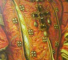 Bodice jewels and the large vertical slashes shown in Mor's portrait of Isabel Valois of about 1568. Her jeweled crucifix is prominent, but the pearl quartets, embroidery, and rich under-garment are also of interest. So are the tabbed sleeves.