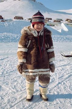 An Inuit child from Arctic Bay in traditional Baffin Island dress.