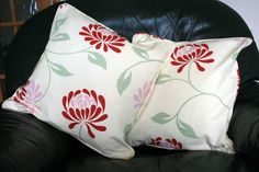 CLEARANCE SALE - 50% off  Was £8.00, now £4.00  These beautiful floral cushion covers have large red and pink flowers printed on a cream background. They are 18 in size, zipped at the bottom and made from the same fabric on both sides with matching piping. Please note that the price is only for the cushion cover, the pads are NOT included.  There is a variation of the position of the flowers on each cushion.