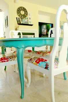 Turquoise table with print chairs, this would be so nice for a breakfast nook or craft table.