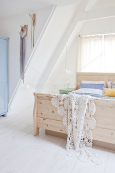 White bedroom with pastel furniture