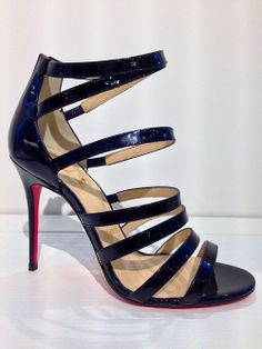 """Meet """"Mariniere"""", Christian Louboutin's strappy black patent leather sandal with a 100mm heel."""