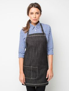 The Harvest Mini Bib Apron in Black Denim is a fun look and a perfect fit for the petite members of your crew. This designer apron is suitable as a hospitality uniform in cafes and restaurants, and looks sharp paired with a classic striped tee. All features are the same as the original design you love with durable cotton denim that fades with age and grows in character, a large front pocket and adjustable button neck strap. Also available in Indigo Denim, as a bib, and short waist…