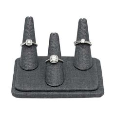 This Pretty Fingers™️ gray linen display holds three rings (size 4 and up) in a staggered arrangement of finger-shaped forms. The gray linen offers a sophisticated dark color and a subtle texture with a visible weave. Place an individual ring on each form, or highlight stacked ring combinations. This finger display presents jewelry on a realistic form that both provides a great view of how the piece will look when worn and creates an eye-catching visual element in your display. Ring Displays, Jewelry Displays, Fabric Display, Rio Grande Jewelry, Three Rings, Bold Jewelry, Subtle Textures, Doll Shoes, Jewelry Making Supplies