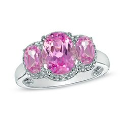 Oval Lab-Created Pink Sapphire and Diamond Accent Three Stone Ring in 10K White Gold