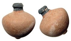 "Byzantine Empire, c. 8th - 10th Century AD. Excellent terracotta ""Greek Fire"" hand grenade. Nice rounded form with nipple at base and black slip on the spout. H: 4"" (10.2 cm). Intact with light earthen deposits. Ex Thomas Cotterill collection, early 19th Century, UK. #AB2004: $525"