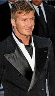 So, Becks, forget the shiny wide lapels - but the grandpa collar + ascot tie are a  winning combo.