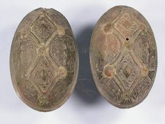 Viking brooches, found in Linköping, Sweden. The archaeological evidence shows that women were often buried in their best outfits, including a pair of oval brooches of gilt bronze, which held up a woollen overdress worn with a linen underdress.
