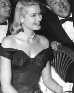 Grace Kelly. Kind of funny how Gene Kelly is like no big deal in this pic.