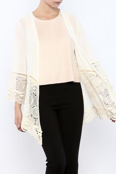 Kimono with lace trim on the bottom half of the body as well as the sleeves. Lightweight chiffon-like material. Hand wash cold separately no bleach hang to dry.  Lace Trim Kimono by She  Sky (Ya Los Angeles). Clothing - Jackets Coats & Blazers - Kimonos & Wraps Iowa