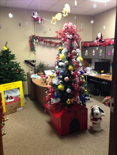 Charlie Brown Christmas Office Decoration. Snoopy's dog house as a tree stand