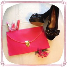 "HPPink Envelope Clutch Cute pink envelope clutch with gold hardware. Comes with a detachable gold chain to wear as a shoulder bag with a 20"" drop. Thick faux leather. 7"" Height x 11"" Length NWOT Bags Clutches & Wristlets"