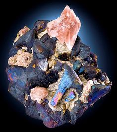 Bornite coated Chalcopyrite crystals with pinkish Calcite | Geology IN