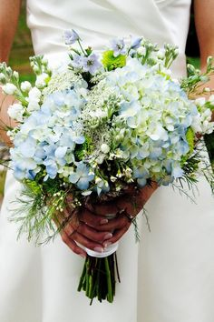 Hydrangeas increase the romantic feel of this bouquet.great idea for adding that something extra to a wild flower bouquet. Love this but darker blue hydrangea Blue Wedding Flowers, Bridal Flowers, Blue Flowers, Mod Wedding, Dream Wedding, Wedding Ideas, Wedding Veils, Wedding Hair, Bridal Hair