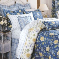 A weekend in the country. Emilie Bedding by Laura Ashley brings the beauty of the country home. A yellow, green, and light blue floral pattern on a darker blue background, with the same pattern on a white background on the reverse side, is reminiscent of the idyllic life in a peaceful rural setting. You'll feel refreshed like you're waking up to a wholesome country morning when you dress your bed in this attractive bedding ensemble. Starting at $19.99